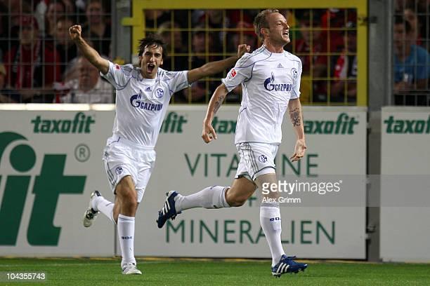 Ivan Rakitic of Schalke celebrates his team's first goal with team mate Raul Gonzalez during the Bundesliga match between SC Freiburg and FC Schalke...