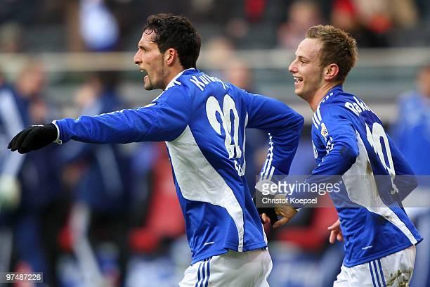 Ivan Rakitic of Schalke celebrates the third goal with Kevin Kuranyi of Schalke during the Bundesliga match between Eintracht Frankfurt and FC...