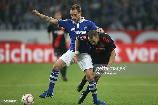 Ivan Rakitic of Schalke challenges Michal Kadlec of Leverkusen during the Bundesliga match between FC Schalke 04 and Bayer Leverkusen at the Veltins...