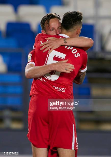Ivan Rakitic of Sevilla FC celebrates after scoring his team's second goal with his teammate Lucas Ocampos during the La Liga Santander match between...