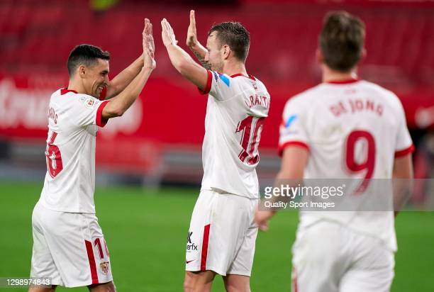 Ivan Rakitic of Sevilla FC celebrates after scoring his team's third goal with his teammate Jesus Navas during the Copa del Rey 4th Round match...