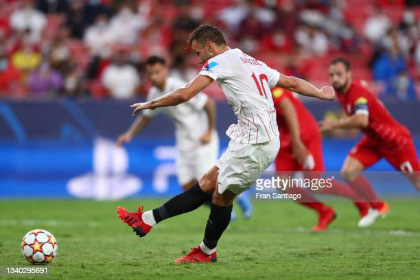 Ivan Rakitic of Sevilla FC scores their team's first goal from a penalty during the UEFA Champions League group G match between Sevilla FC and RB...