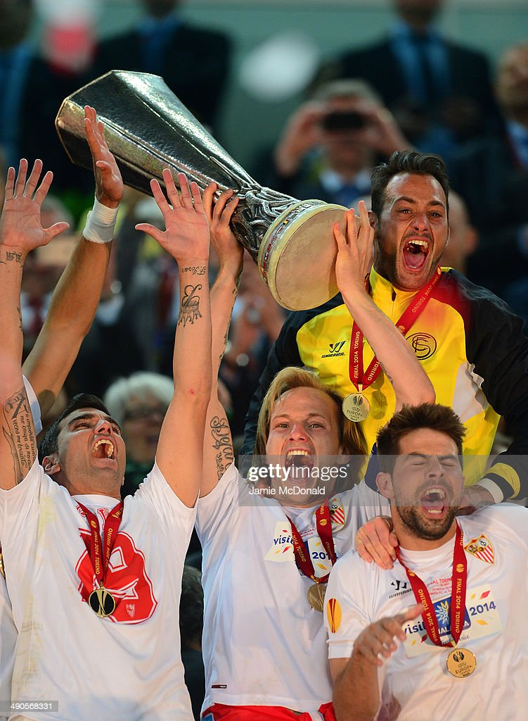 Ivan Rakitic of Sevilla lifts the Europa League trophy during the UEFA Europa League Final match between Sevilla FC and SL Benfica at Juventus Stadium on May 14, 2014 in Turin, Italy.