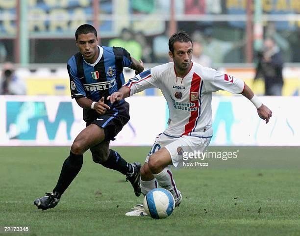 Ivan Ramiro Cordoba of Inter and Giuseppe Mascara of Catania in action during the Serie A match between Inter Milan and Catania Calcio at San Siro...