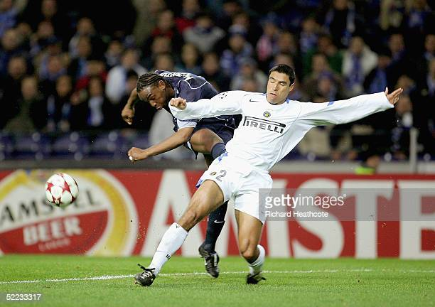 Ivan Ramiro Cordoba of Inter blocks a shot by Benni McCarthy of Porto during The UEFA Champions League knockout stage 1st leg match between Porto and...