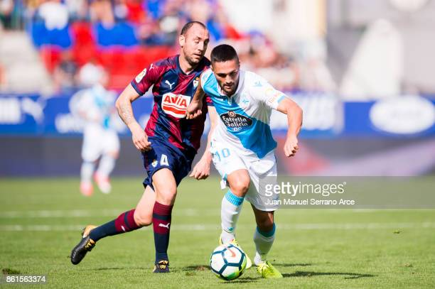 Ivan Ramis of SD Eibar duels for the ball with Florin Andone of RC Deportivo La Coruna during the La Liga match between SD Eibar and RC Deportivo La...