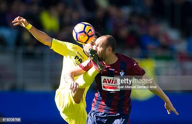 Ivan Ramis of SD Eibar duels for the ball with Nicola Sansone of Villarreal CF during the La Liga match between SD Eibar and Villarreal CF at Ipurua...