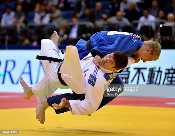 Ivan Remarenco of the United Arab Emirates throws Cyrille Maret of France for ippon on his way to the u100kg bronze medal during the Chelyabinsk Judo...