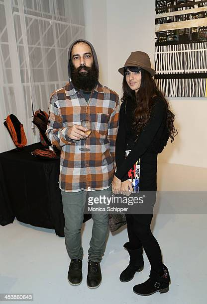 Ivan Ridriguez and Ingrid Strubing attend 'love art give a smile' Art Fashion And Design Benefit at Clen Gallery on December 5 2013 in New York City