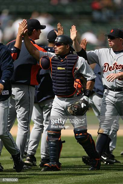 Ivan Rodriguez and Chris Shelton of the Detroit Tigers celebrate a victory against the Oakland Athletics at the Network Associates Coliseum in...