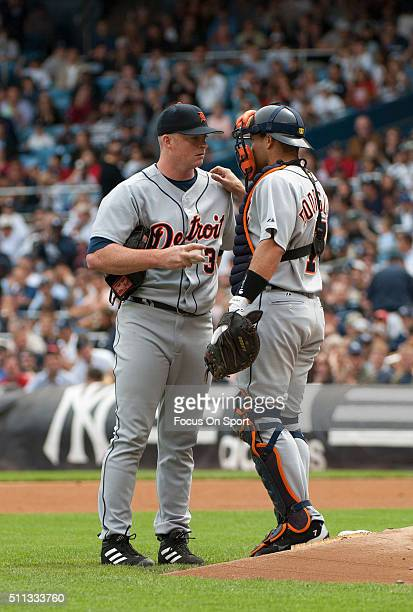 Ivan Rodriguez if the Detroit Tigers talks with his pitcher Jeremy Bonderman against the New York Yankees during an Major League Baseball game August...