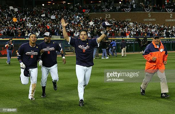 Ivan Rodriguez Neifi Perez and Carlos Guillen of the Detroit Tigers celebrate winning 63 against the Oakland Athletics during Game Four of the...