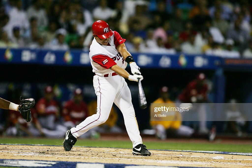 Ivan Rodriguez #7 of Puerto Rico bats against Venezuela in the second round of the World Baseball Classic at Hiram Bithorn Stadium on March 13, 2006 in San Juan, Puerto Rico. Venezuela defeated Puerto Rico 6-0.