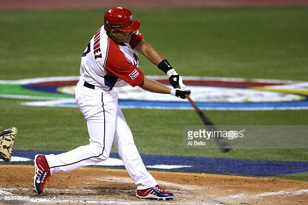 Ivan Rodriguez of Puerto Rico hits the ball against The Netherlands during the 2009 World Baseball Classic Pool D match on March 9, 2009 at Hiram...