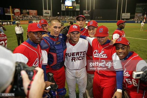 Ivan Rodriguez of Puerto Rico is pictured with members of Team Cuba after the game on March 15 2006 at Hiram Bithorn Stadium in San Juan Puerto Rico...