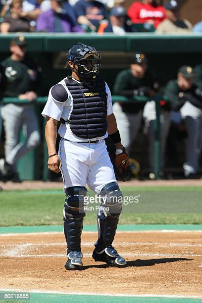 Ivan Rodriguez of the Detroit Tigers catches during the game against the Pittsburgh Pirates at the Joker Marchant Stadium in Lakeland Florida on...