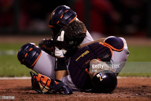 Ivan Rodriguez of the Detroit Tigers reacts after being hit by a foul tip against the St Louis Cardinals during Game Three of the 2006 World Series...