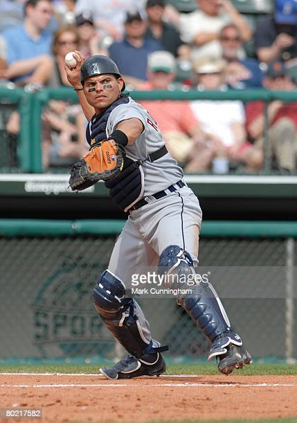 Ivan Rodriguez of the Detroit Tigers throws during the spring training game against the Atlanta Braves at Champion Stadium in Lake Buena Vista...