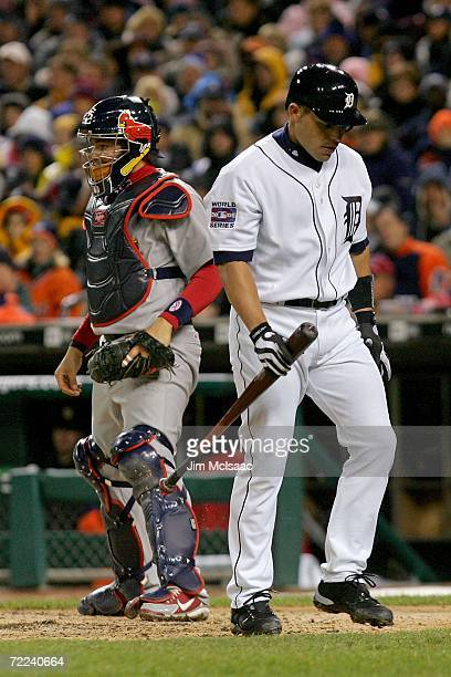 Ivan Rodriguez of the Detroit Tigers walks back to the dugout after striking out against the St Louis Cardinals during Game Two of 2006 World Series...