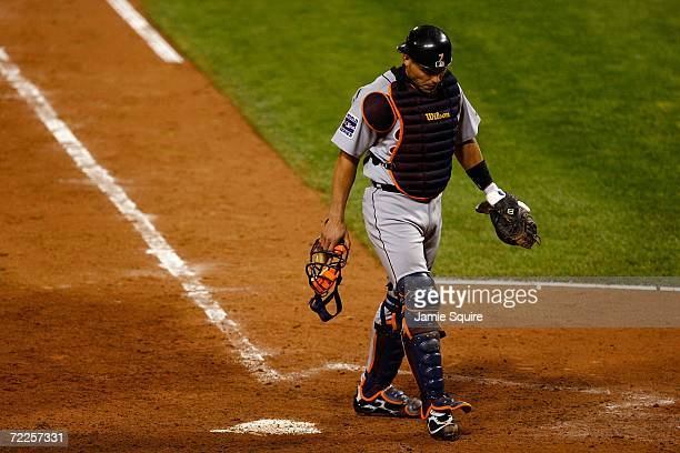 Ivan Rodriguez of the Detroit Tigers walks behind the plate after he was hit by a foul tip in the eighth inning against the St Louis Cardinals during...