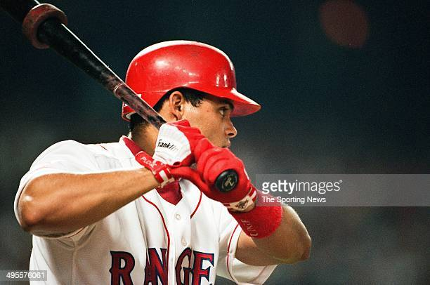 Ivan Rodriguez of the Texas Rangers bats against the Milwaukee Brewers at The Ballpark in Arlington on September 14 1996 in Arlington Texas The...