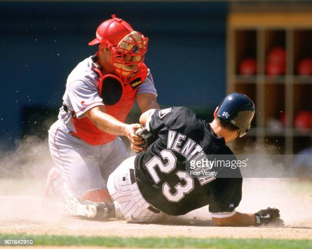 Ivan Rodriguez of the Texas Rangers catches during an MLB game versus the Chicago White Sox at Comiskey Park in Chicago Illinois during the 1998...