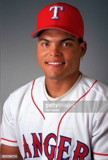 Ivan Rodriguez of the Texas Rangers poses for a photo prior to a major league baseball spring training game in Port Charlotte Florida during the 1997...