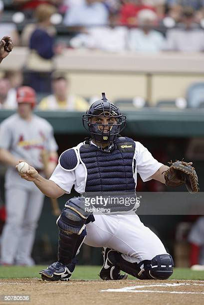 Ivan Rodriquez of the Detroit Tigers looks throw the ball back to the mound during the game against the St Louis Cardinals at Marchant Stadium on...