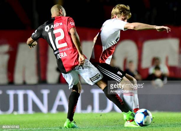 Ivan Rossi of River Plate fights for the ball with Diego Vera of Colon during a match between Colon and River Plate as part of Torneo Primera...