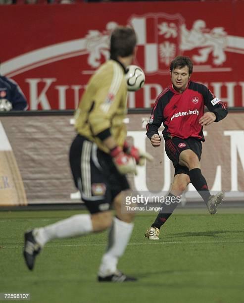 Ivan Saenko of Nuremberg challenges Joerg Butt of Leverkusen during the Bundesliga match between 1.FC Nuremberg and Bayer Leverkusen at the...