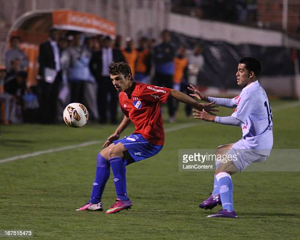 Ivan Santillan of Real Garcilaso fights for the ball with Ivan Alonso of Nacional during the match between Real Garcilaso of Peru and Nacional of...