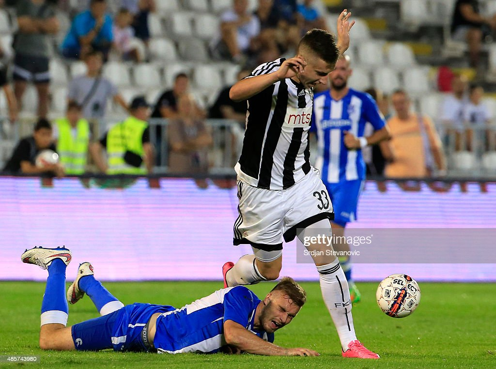 BELGRADE, SERBIA - AUGUST 29. Ivan Saponjic (R) of FK Partizan in action against Bogdan Planic (L) of OFK Belgrade during the Serbia Super League match between FK Partizan and OFK Belgrade at Partizan stadium August 29, 2015 in Belgrade, Serbia.