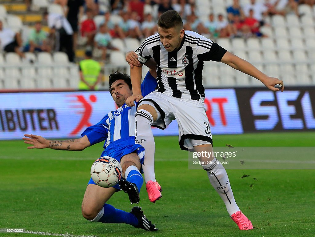 Ivan Saponjic (R) of FK Partizan try to scores near Nikola Ignjatijevic (L) of OFK Belgrade during the Serbia Super League match between FK Partizan and OFK Belgrade at Partizan stadium on August 29, 2015 in Belgrade, Serbia.