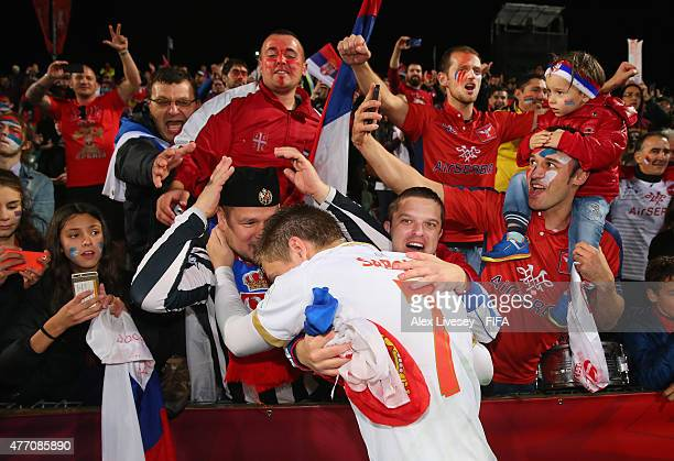 Ivan Saponjic of Serbia celebrates with fans after victory over USA in a penalty shoot out in the FIFA U20 World Cup Quarter Final match between USA...