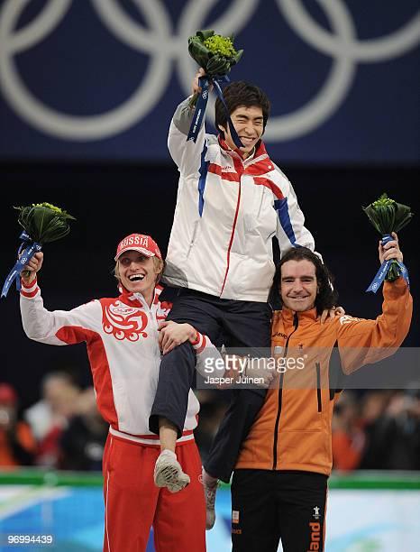 Ivan Skobrev of Russia celebrates winning silver, Lee Seung-Hoon of South Korea gold and Bob De Jong of Netherlands bronze during the flower ceremony...