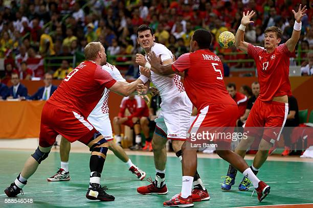 Ivan Sliskovic of Croatia is challenged by Mads Mensah Larsen of Denmark during the Mens Preliminary Group A match between Denmark and Croatia at...