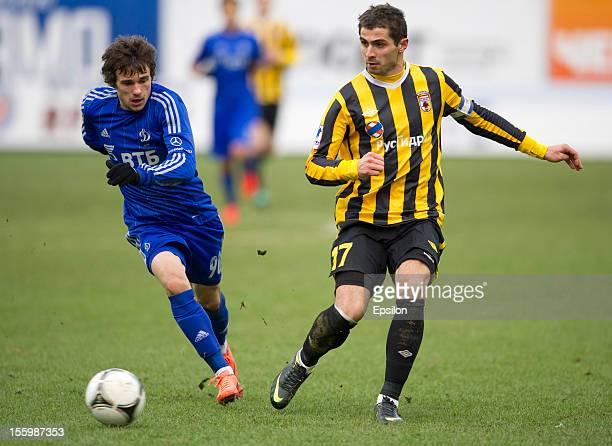 Ivan Soloviyev of FC Dynamo Moscow battles for the ball with Taras Tsarikayev of FC Alania Vladikavkaz during the Russian Premier League match...
