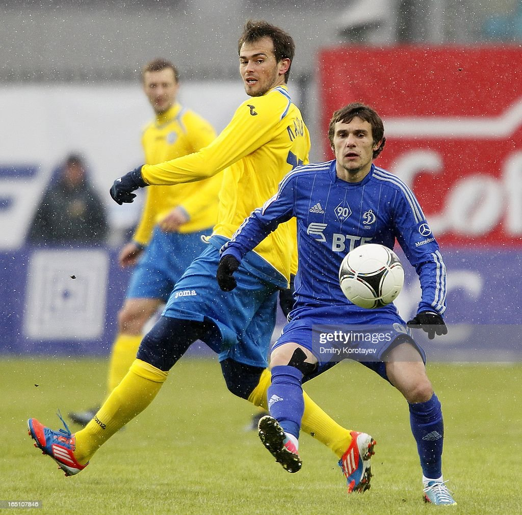 Ivan Solovyov of FC Dynamo Moscow is challenged by Danko Lazovic (R) of FC Rostov Rostov-on-Don during the Russian Premier League match between FC Dynamo Moscow and FC Rostov Rostov-on-Don at the Arena Khimki Stadium on March 30, 2013 in Khimki, Russia.