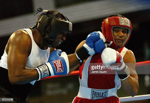 Ivan Stovall punches Anthony Dirrell during bout of the United States Olympic Team Boxing Trials at Battle Arena on February 19 2004 in Tunica...