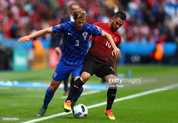 Ivan Strinic of Croatia and Arda Turan of Turkey compete for the ball during the UEFA EURO 2016 Group D match between Turkey and Croatia at Parc des...