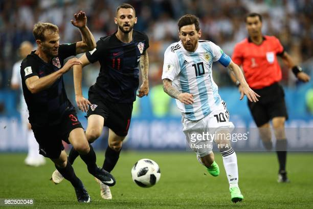 Ivan Strinic of Croatia and Lionel Messi of Argentina battle for the ball during the 2018 FIFA World Cup Russia group D match between Argentina and...