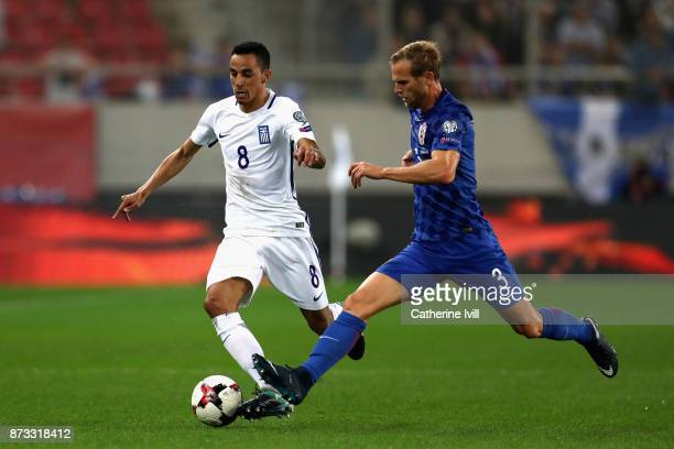 Ivan Strinic of Croatia and Zeca of Greece in action during the FIFA 2018 World Cup Qualifier PlayOff Second Leg between Greece and Croatia at...