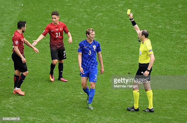 Ivan Strinic of Croatia is shown a yellow card by Referee Jonas Eriksson during the UEFA EURO 2016 Group D match between Turkey and Croatia at Parc...