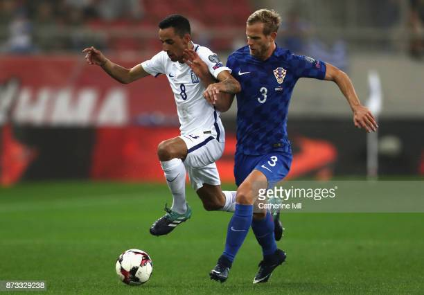 Ivan Strinic of Croatia tackles Zeca of Greece during the FIFA 2018 World Cup Qualifier PlayOff Second Leg between Greece and Croatia at Karaiskakis...