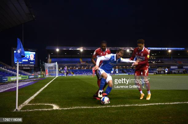 Ivan Sunjic of Birmingham City holds of Anfernee Dijksteel and Marcus Tavernier of Middlesbrough during the Sky Bet Championship match between...