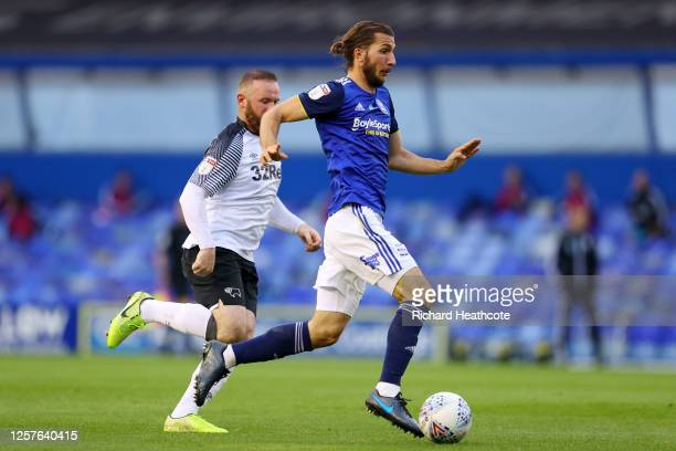 Ivan Sunjic of Birmingham City is challenged by Wayne Rooney of Derby County during the Sky Bet Championship match between Birmingham City and Derby...