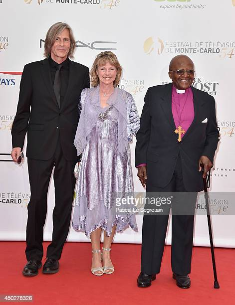 Ivan Suvanjieff Dawn Engle and Desmond Tutu attend a photocall during the 54th MonteCarlo Television Festival at Grimaldi Forum on June 8 2014 in...