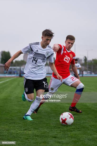 Ivan Tarasov of Russia competes with Nick Batzner of Germany during the U18 international friendly match between Russia and Germany at Zenith Stadium...