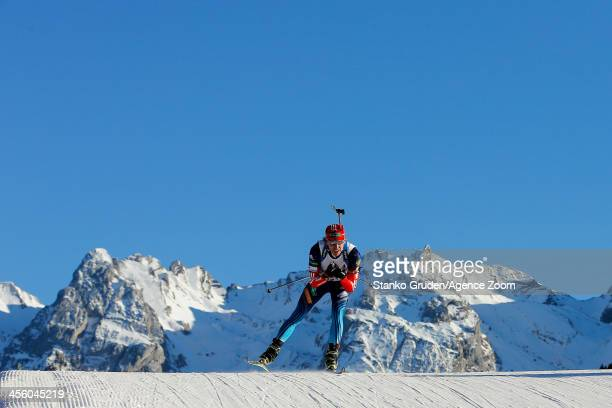 Ivan Tcherezov of Russia takes 1st place during the IBU Biathlon World Cup Men's Relay on December 13, 2013 in Annecy-Le Grand Bornand, France.