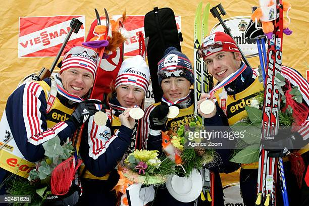 Ivan Tcherezov, Olga Pyleva, Svetlana Ishmouratova and Nikolay Kruglov of Russia celebrate winning the 4X6 kilometer Mixed Relay during the Biathlon...